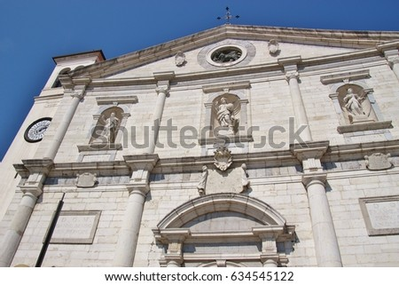 Facade of the late renaissance cathedral of Palmanova,  erected in 1636. The town Palmanova was built up by the Venetians in 1593. Northeastern Italy, Europe. #634545122