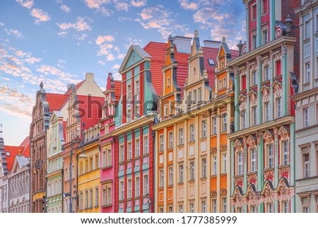 Facade of traditional, colorful, historical tenement houses at Old Market Square, the Old Town in Wroclaw, Lower Silesia, Poland. Tourism in Poland