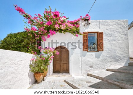 Facade of traditional white house in Lindos town at Rhodes island #1021066540