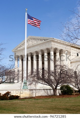 Facade of US Supreme court in Washington DC on sunny day - stock photo