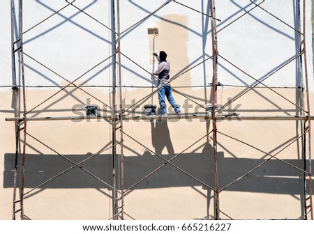 facade painting works  - Shutterstock ID 665216227