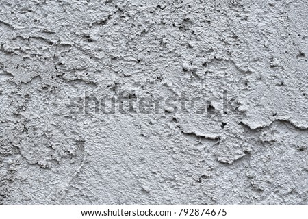 Facade plaster background. Single-ply monolithic plaster decorative background. Single layer scraped cement plaster wallpaper. Exterior building structure backdrop. Silica  sand Cement Wall Plaster.