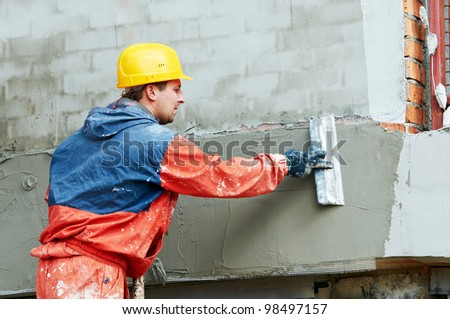 Facade Plasterer at outdoor wall renovation decoration with float