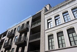 Facades in Brussels, old building and new building side by side