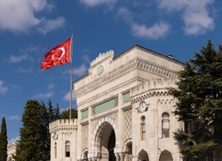 Facades of ancient buildings in Istanbul city on the background of blue sky on a sunny summer day, public places