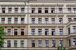 Facades of beautifully renovated old buildings in the Eberswalder street in Berlin (Germany), district of Prenzlauer Berg.