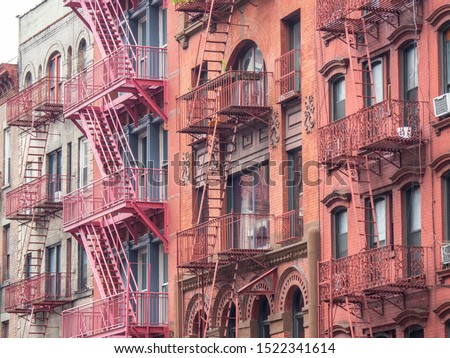 Facades of historic buildings in the Soho district of New York. The characteristic iron safety stairs on the facades