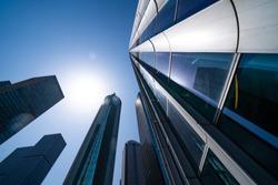 Facades of modern city buildings in the sun
