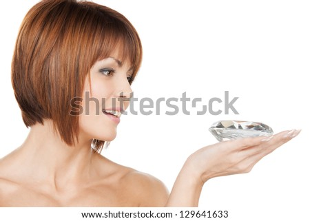 face and hands of beautiful woman with diamond