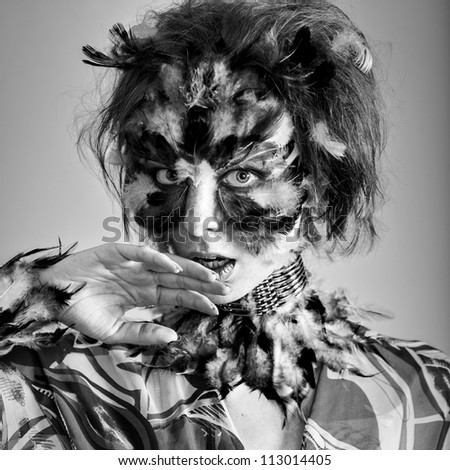 Face art  make up feather mask model look at camera