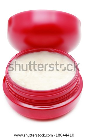 Face cream isolated over white background