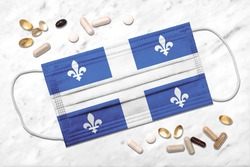Face mask with flag of Quebec during coronavirus pandemic