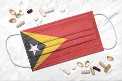 Face mask with flag of Timor-Leste during coronavirus pandemic