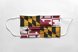 Face mask with Maryland flag printed, on white background, isolated safety concept