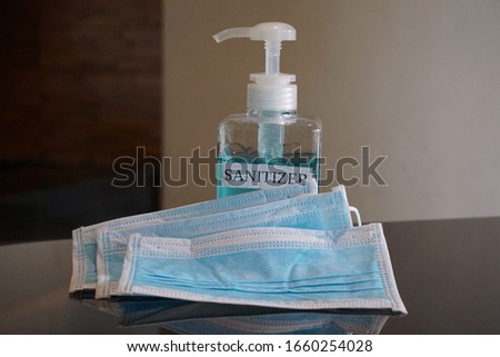 Face masks and hand sanitizer bottle  for washing to help stop spreading covid-19 for public healthcare safety all personal crisis management. Concept Healthcare, Sanitizer, Face Mask, hygiene hands.