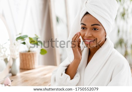 Face Massage. Beautiful African American Girl Touching Her Soft Skin After Bath, Massaging For Better Lifting And Elasticity, Free space