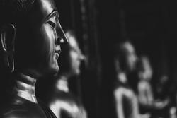 Face monk statue black and white, Buddhist religion buddha meditation.