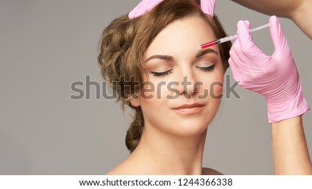 Face needle injection. Young woman cosmetology procedure. Doctor gloves. #1244366338