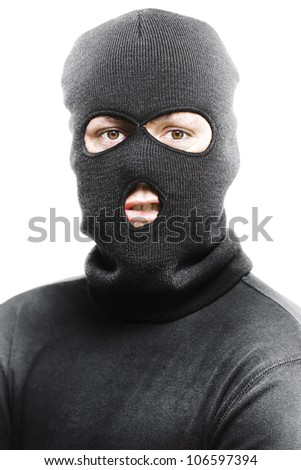 Face of a angry burglar wearing a black ski mask or balaclava isolated on white background
