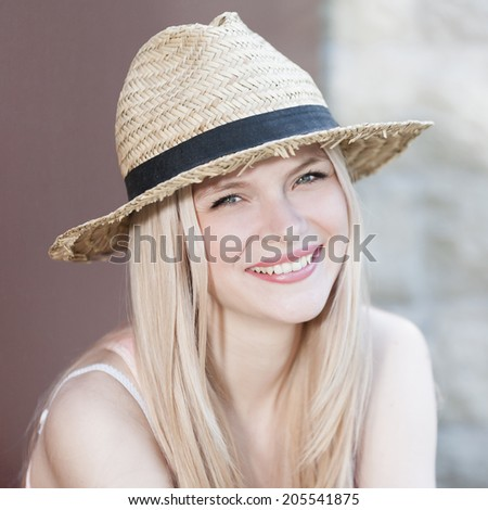 Stock Photo face of a beautiful blonde girl with blue eyes