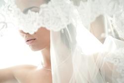 face of a beautiful bride hidden veil