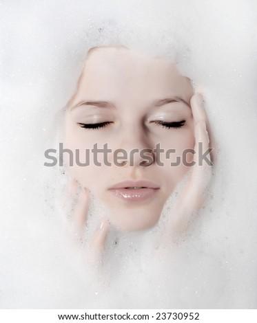 face of a beautiful woman in white foam