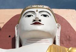 Face of a Buddha statue, Four Seated Buddha Shrine, at Kyaikpun Pagoda in Bago, Burma, Myanmar