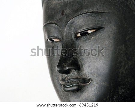 Face of a Buddha Statue Isolated on a White Background with Plenty of Copy Space