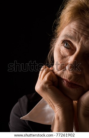 face of a cute aged woman  on black
