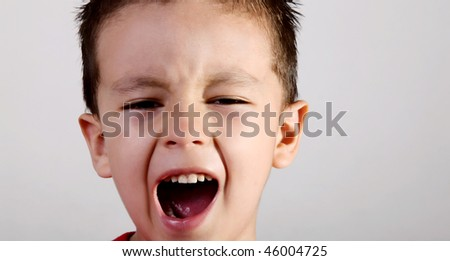 Face of a screaming child on white background.