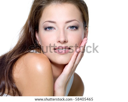 Face of a sexy beautiful young woman with clean skin on a white background