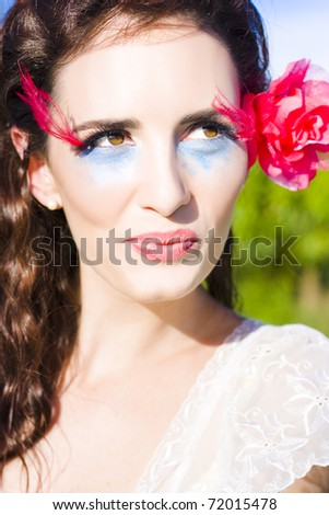 Face Of A Smiling Happy Woman With A Rose Flower In Her Hair Looking To The Side Thinking Romantic Thoughts