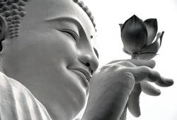 face of a white Buddha with a lotus in his hand, Dalat, Vietnam