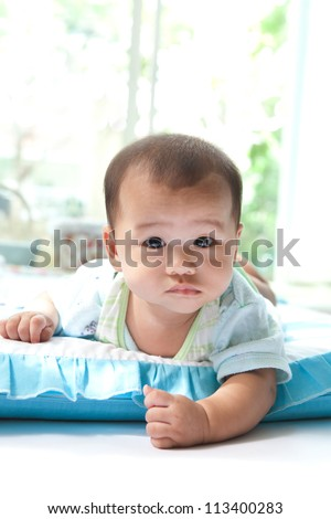 face of baby in living room at home