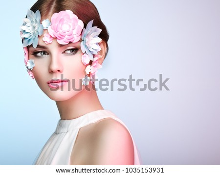 Face of Beautiful Woman Decorated with Flowers. Perfect Makeup. Beauty Fashion Model Woman Face perfect Skin. Paper Flowers #1035153931