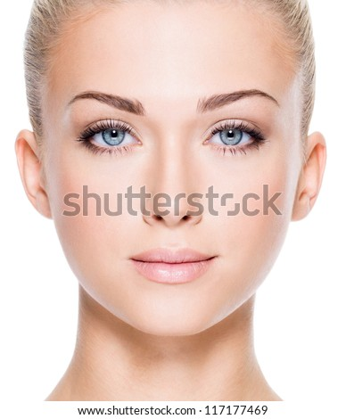 Stock Photo Face of beautiful young woman with beautiful blue eyes  - Closeup image on white background