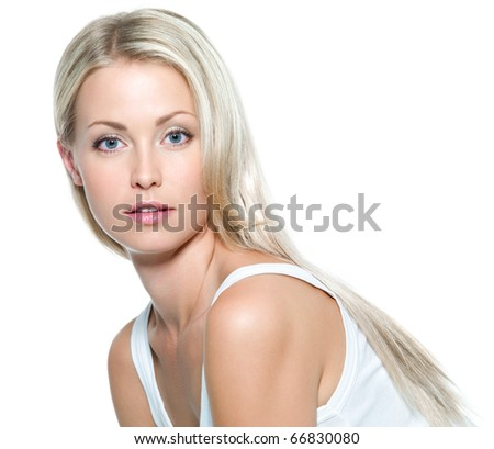 Face of  beautiful young woman with clean skin on a white background