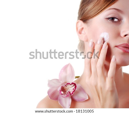 face of beautiful young woman with delicate orchid