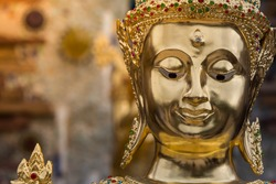 Face of Buddha statue golden close up in Thailand