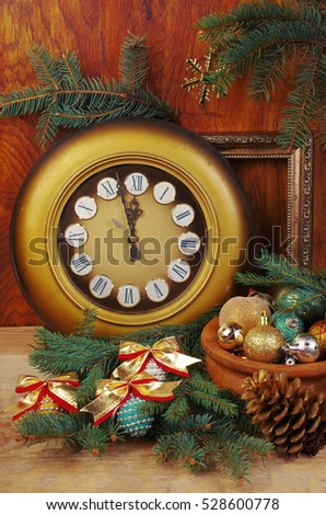 Face of clock and new year decorations.Wooden background. #528600778