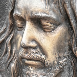 Face of jesus. Ancient sculpture. Bronze statue of the face of jesus. Ideal for concepts or events like Easter.