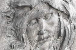 Face of Jesus Christ (fragment of statue). Antique stone statue of Jesus Christ.