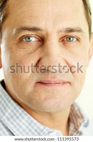 Face of mature man looking at camera