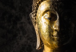 Face of statue Buddha close up at Wat Phra That Doi Suthep is a Theravada wat in Chiang Mai Province, Thailand. The temple is often referred to as Doi Suthep