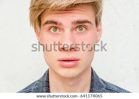 Face of teenager boy staring straight closeup - Shutterstock ID 641174065