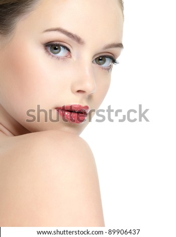 Face of young beautiful woman with clean skin and bright red lipstick on her lips - isolated
