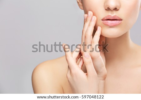 Face of young woman on light background #597048122