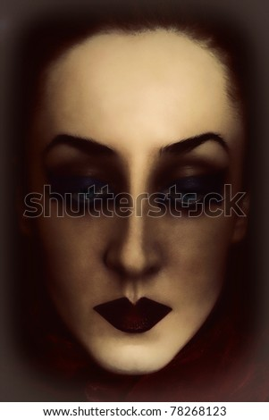 face of young woman with bright gothic makeup closeup