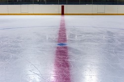 Face off blue spot with red line on hockey rink