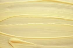 Face or body cream banana yellow texture background
